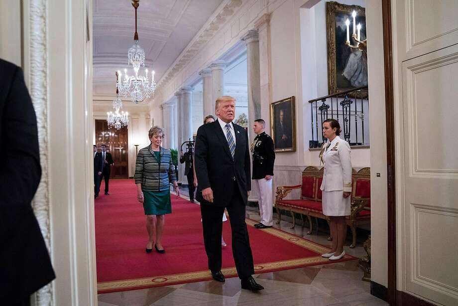 President Trump at the White House on Tuesday when he posted a signing statement to explain how he viewed the Russia sanctions law sent to him by Congress. Photo: Jabin Botsford, The Washington Post