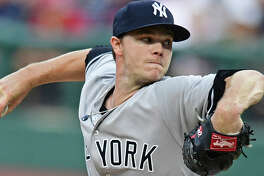 New York Yankees starting pitcher Sonny Gray delivers in the first inning of a baseball game against the Cleveland Indians, Thursday, Aug. 3, 2017, in Cleveland. (AP Photo/David Dermer)