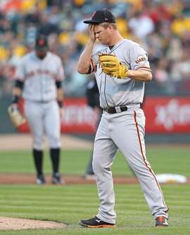 San Francisco Giants' Matt Cain wipes his face after giving up two runs to Oakland Athletics in 1st inning during MLB game at Oakland Coliseum in Oakland, Calif. on Monday, July 31, 2017.