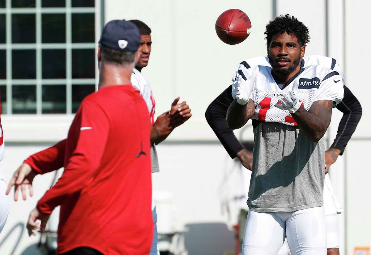 Braxton Miller works on his technique during training camp Wednesday. The spotlight intensifies on the converted QB while WR Will Fuller is out with injury.