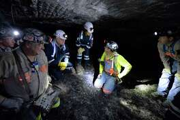 In 2015, Joe Main, third from left, assistant secretary of labor for mine safety and health, and Patricia Silvey, center, a deputy at the U.S. Mine Safety and Health Administration, speak with workers at the Gibson North mine in Princeton, Ind. Deaths in U.S. coal mines are rising this year.