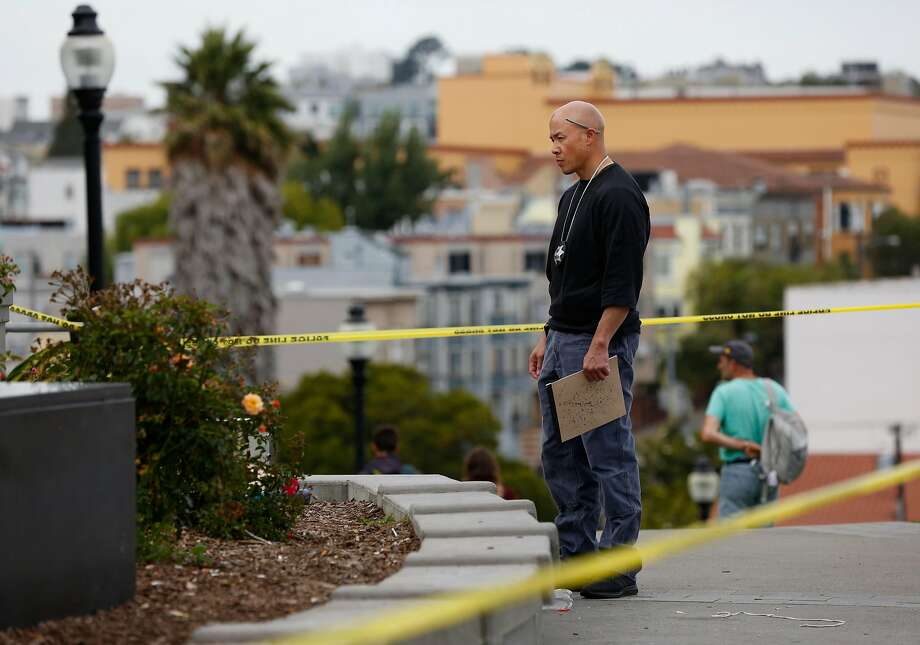 A police officer investigates a shooting at Dolores Park in San Francisco last month. Photo: Leah Millis, The Chronicle