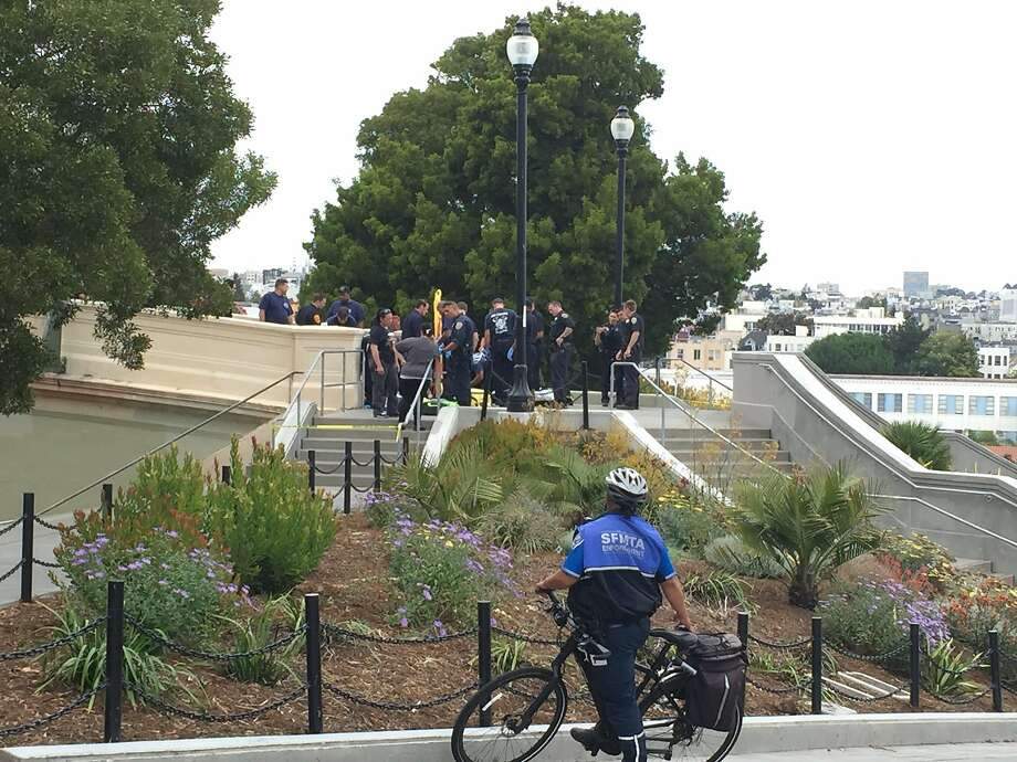 This Thursday, Aug. 3, 2017, photo courtesy of Antonia Juhasz shows San Francisco Police officers and paramedics at Dolores Park in San Francisco. Police say three people were shot at a popular San Francisco park. The San Francisco Police Department says people should stay away from Dolores Park, where the shooting happened Thursday afternoon. (Antonia Juhasz via AP) Photo: Antonia Juhasz, Associated Press