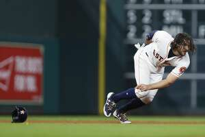 Houston Astros Jake Marisnick (6) dives back to second base on Jose Altuve's single during the fifth inning of an MLB game at Minute Maid Park, Thursday, Aug. 3, 2017, in Houston. ( Karen Warren / Houston Chronicle )