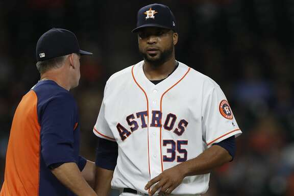 Houston Astros relief pitcher Francisco Liriano (35) gets pulled after facing two batters during the seventh inning of an MLB game at Minute Maid Park, Thursday, Aug. 3, 2017, in Houston. ( Karen Warren / Houston Chronicle )