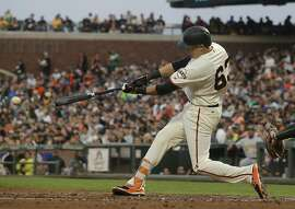 San Francisco Giants' Ryder Jones hits an RBI-single against the Oakland Athletics during the second inning of a baseball game in San Francisco, Thursday, Aug. 3, 2017. (AP Photo/Jeff Chiu)