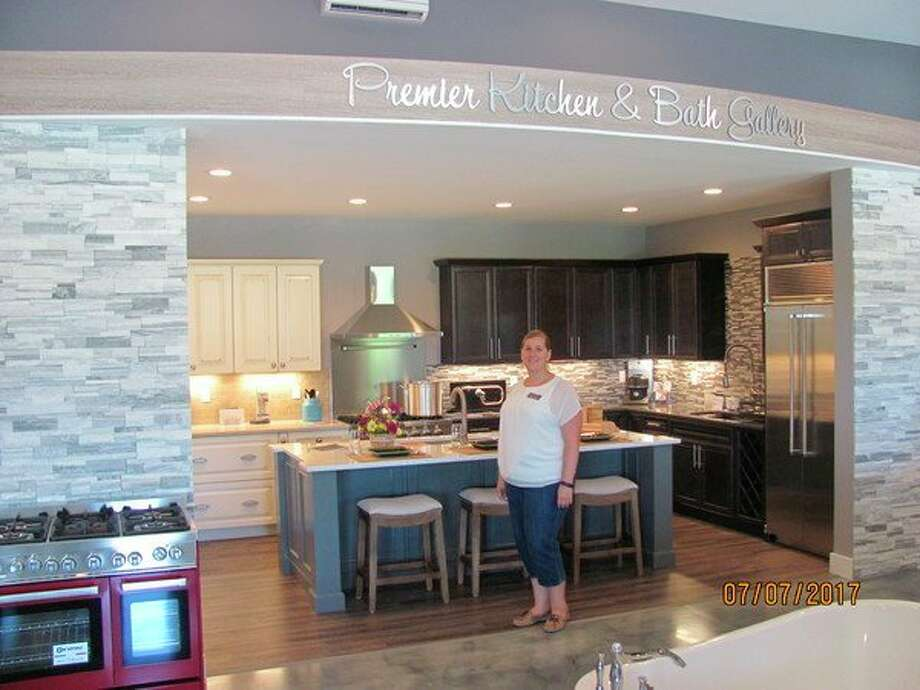 Elegant Premier Kitchen And Bath Gallery General Manager Deeann Hall Poses In The  Storeu0027s Showroom At 800