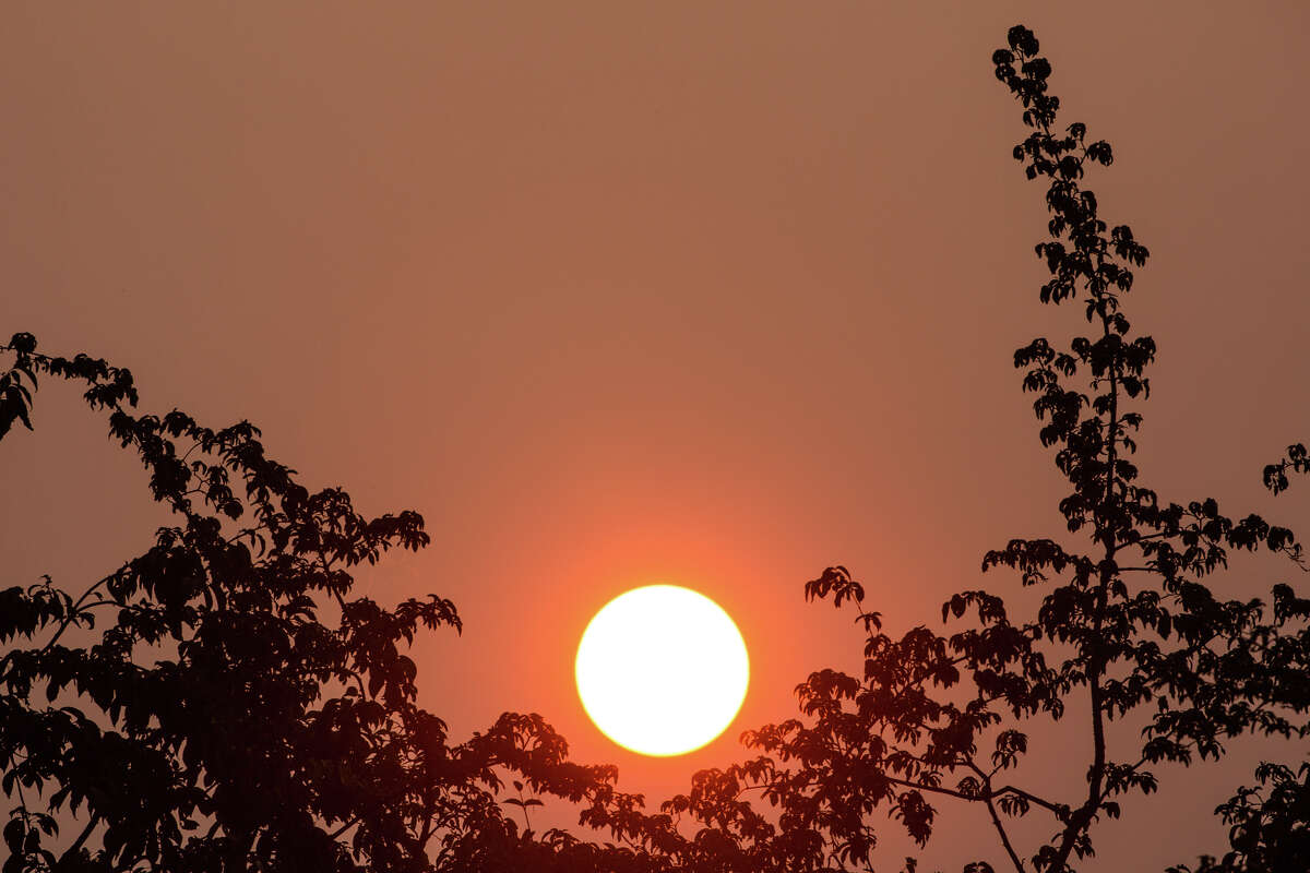 Haze from wildfires in British Columbia cause a strange, red sunset in Seattle on Thursday, Aug. 3, 2017.