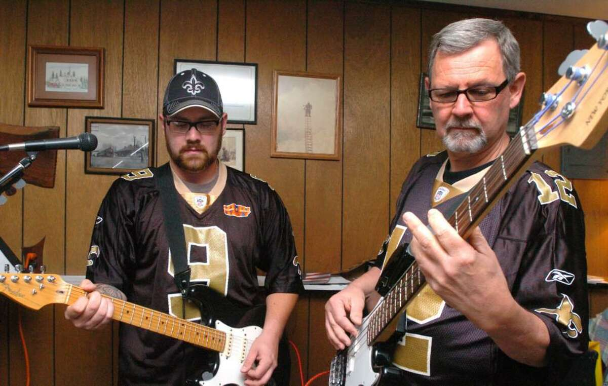 Robert Cullen and his son, Pete Cullen, practice their instruments in New Fairfield. Robert is a retired custodian for the Board of Education and Pete is a track worker for Metro-North Railroad.