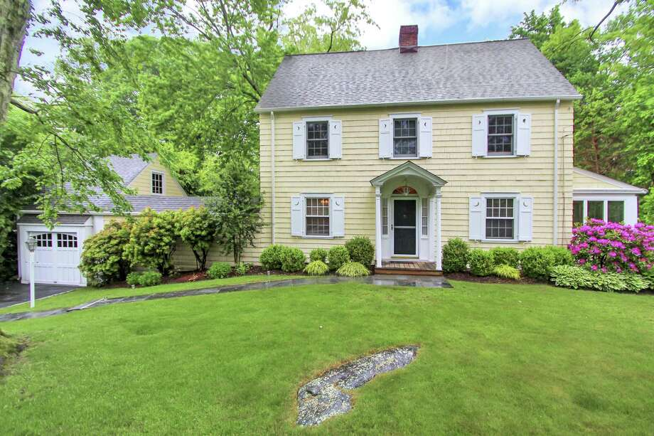 The yellow colonial house at 17 McLaren Road is walking distance to Royle Elementary School and less than a mile to downtown and the Metro North train station.