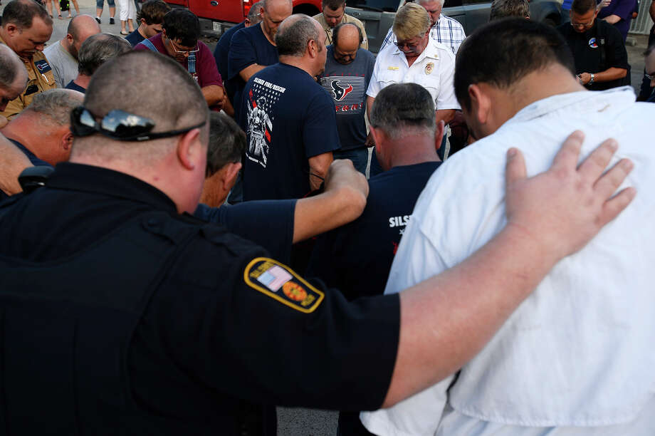 Silsbee volunteer firefighters pray after a meeting at the Silsbee Volunteer Fire Department on Thursday night. Assistant Chief Jay Hinkie was struck and killed by a motorist while working at a car wreck on FM 418 on Wednesday.  Photo taken Thursday 8/3/17 Ryan Pelham/The Enterprise Photo: Ryan Pelham / ©2017 The Beaumont Enterprise/Ryan Pelham