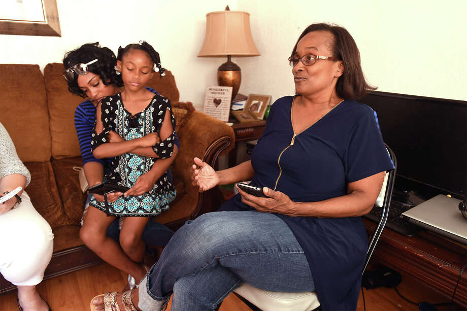Lidia Chargois talks Thursday about her brother Brandon Keith Pratt, 32, who was shot and killed Wednesday on Pine Burr Boulevard in Beaumont, Tierra Pratt and Zhanaria Judge, 9, are also pictured.  Photo taken Thursday, August 03, 2017 Guiseppe Barranco/The Enterprise Photo: Guiseppe Barranco, Photo Editor / Guiseppe Barranco ©