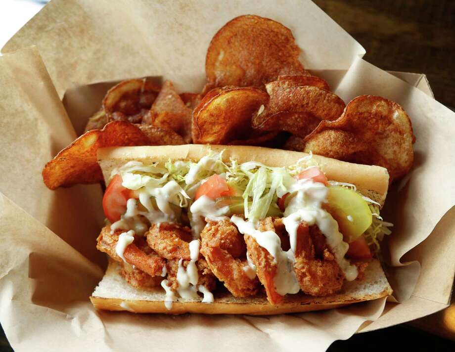 Fried shrimp po'boy with house-made chips at the South Bank Seafood Bar. Photo: Karen Warren, Houston Chronicle / @ 2017 Houston Chronicle