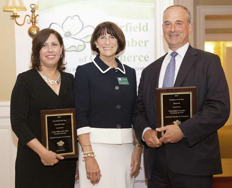 Fairfield Chamber of Commerce President Beverly Balaz, center, presents Operation Hope Executive Director Carla Miklos with the Chambers Nonprofit Organization of the Year award and Bankwell President and CEO Christopher Gruseke with the Company of the Year award. Photo: Contributed Photo / Contributed Photo / New Canaan News