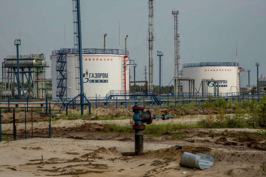 """In this photo taken on Thursday, July 14, 2016, Gazprom oil producing facility situated in the Yamal region, Russia. The indigenous reindeer herders in Russia's northern Yamal Region, a remote section of Siberia where winter temperatures can sink below minus 50 degrees Celsius, are facing a man-made threat as officials push ahead with an unprecedented culling that calls for at least one in seven of the Yamal's reindeer to be slaughtered. Regional government spokeswoman Olesya Litovskikh denied the oil and gas industry lobbied for increased culling. Energy companies spend """"billions of rubles"""" developing far-flung areas and supporting Nenets culture, Litovskikh said. (AP Photo/Petr Shelomovskiy) Photo: Petr Shelomovskiy, STR / Copyright 2016 The Associated Press. All rights reserved."""