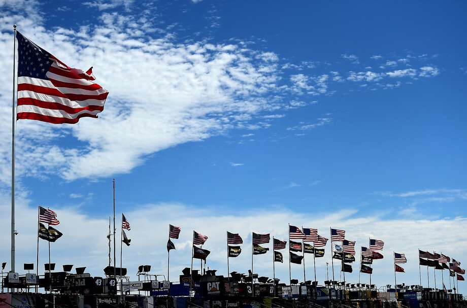 American flags wave in the garage area during practice for the Monster Energy NASCAR Cup Series Overton's 400 at Pocono Raceway on July 29 in Long Pond, Pa. Photo: Jared C. Tilton, Getty Images