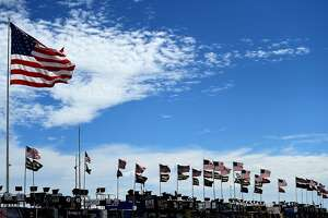 LONG POND, PA - JULY 29:  American flags wave in the garage area during practice for the Monster Energy NASCAR Cup Series Overton's 400 at Pocono Raceway on July 29, 2017 in Long Pond, Pennsylvania.  (Photo by Jared C. Tilton/Getty Images)