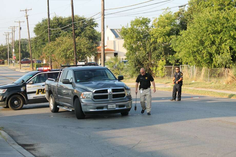 Investigators gather evidence after a 68-year-old man was struck by a pickup Friday, Aug 4, 2017. Photo: Fares Sabawi/San Antonio Express-News