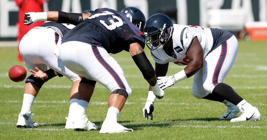 Houston Texans defensive end D.J. Reader (98) goes up against center Nick Martin (66) and guard Josh Walker (73) during training camp at the Greenbrier on Friday, Aug. 4, 2017, in White Sulphur Springs, W.Va. Photo: Brett Coomer, Houston Chronicle / © 2017 Houston Chronicle}