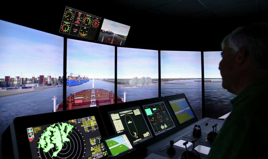 Captain Thomas Goodwin monitors the ship consoles as the large oil tanker is entering a narrow part of the channel during a training simulator exercise at San Jacinto College Maritime Wednesday, Aug. 2, 2017, in La Porte. The simulators are used to prepare for larger ships that are expected to call on the Port of Houston. ( Yi-Chin Lee / Houston Chronicle ) Photo: Yi-Chin Lee, Staff / © 2017  Houston Chronicle
