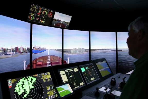 Captain Thomas Goodwin monitors the ship consoles as the large oil tanker is entering a narrow part of the channel during a training simulator exercise at San Jacinto College Maritime Wednesday, Aug. 2, 2017, in La Porte. The simulators are used to prepare for larger ships that are expected to call on the Port of Houston. ( Yi-Chin Lee / Houston Chronicle )