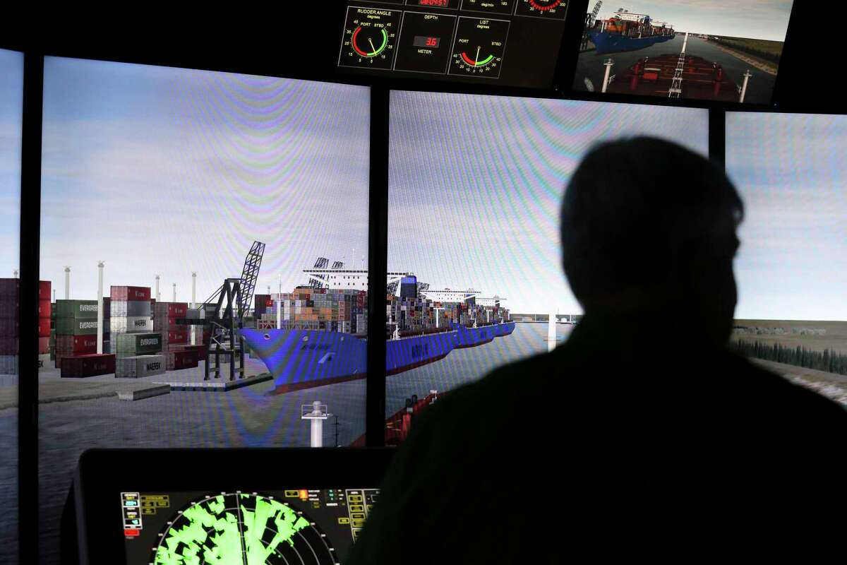 Captain Thomas Goodwin monitors the ship consoles as the large oil tanker is entering a narrow part of the channel during a training simulator exercise at San Jacinto College Maritime Technology and Training Center Wednesday, Aug. 2, 2017, in La Porte. The simulators are used to prepare for larger ships that are expected to call on the Port of Houston. ( Yi-Chin Lee / Houston Chronicle )
