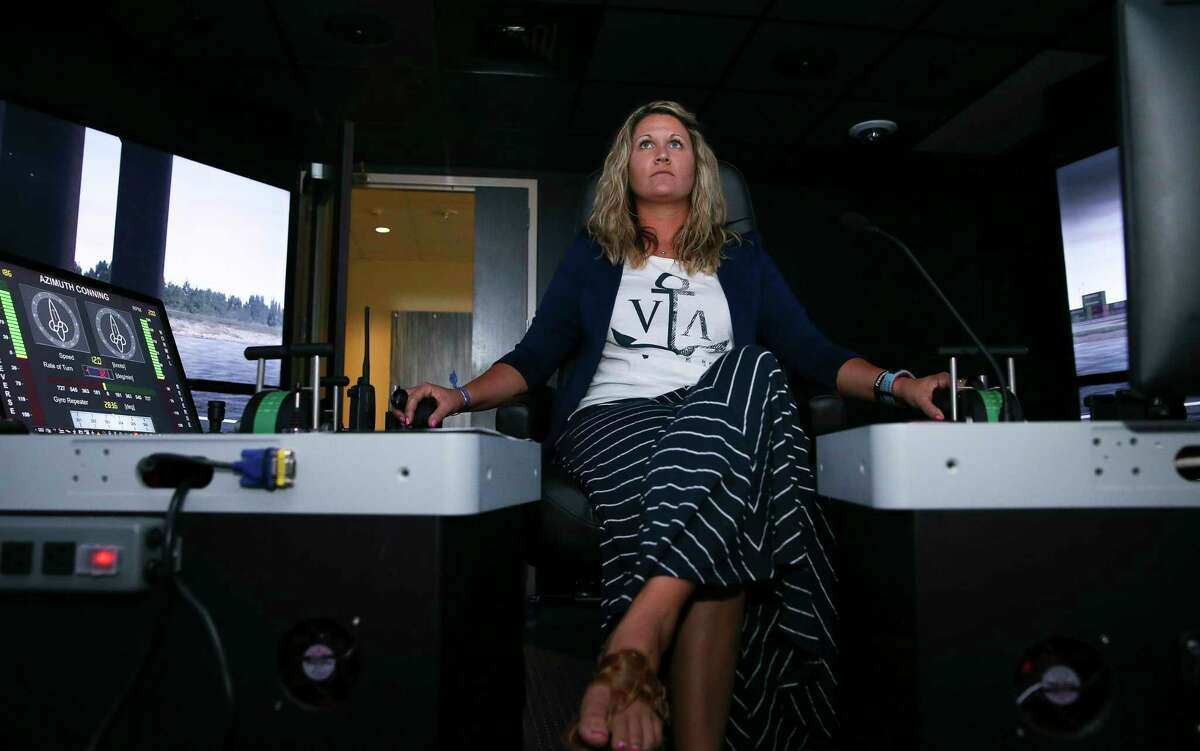 Captain Brandi King drives a tugboat to tow a large oil tanker during a training simulator exercise in a separate room from the tanker pilot at San Jacinto College Maritime Technology and Training Center Wednesday, Aug. 2, 2017, in La Porte. The simulators are used to prepare for larger ships that are expected to call on the Port of Houston. ( Yi-Chin Lee / Houston Chronicle )