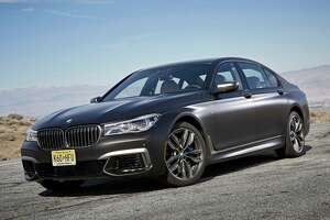 Large air intakes at the outer front corners distinguish the high-performance M760i xDrive from other 7 Series models, which have a different front fascia and fog lights.