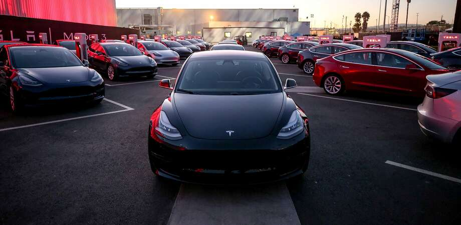 In an update handout photo, Tesla Model 3 cars during an event at the factory handing over its first 30 Model 3 vehicles to employee buyers. The electric-car maker Tesla reported on Aug. 2, 2017, that its losses widened in the second quarter as it continued to invest in factories to accommodate the introduction of its first mass-market vehicle. (Tesla via The New York Times) -- NO SALES; FOR EDITORIAL USE ONLY WITH TESLA EARNINGS BY BILL VLASIC FOR AUG. 3 2017. ALL OTHER USE PROHIBITED. -- Photo: TESLA, NYT