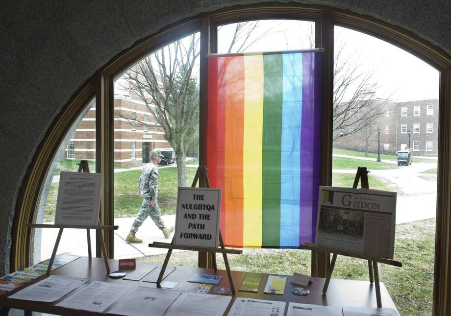 "Alison Redlich / associated press file photo Norwich University's Lesbian, Gay, Bisexual, Transgender, Questioning, and Allies Club  display is seen in the library for guests and students to learn more about their issues and programs  at the Norwich University in Northfield, Vt.  Barely six months after the expiration of the military's ""don't ask, don't tell"" policy prohibiting gay service members from serving openly, the nation's oldest private military academy is holding its first gay pride week. / FR91835 AP"
