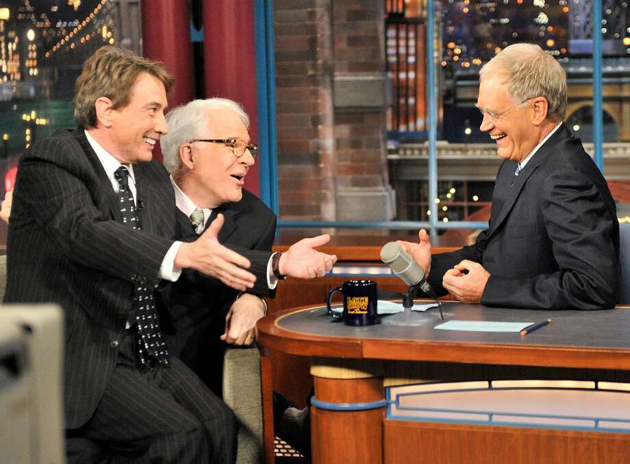 "Martin Short, left, and Steve Martin joke with David Letterman, right, during a taping of ""The Late Show with David Letterman,"" in 2009. Photo: JOHN PAUL FILO, AP"