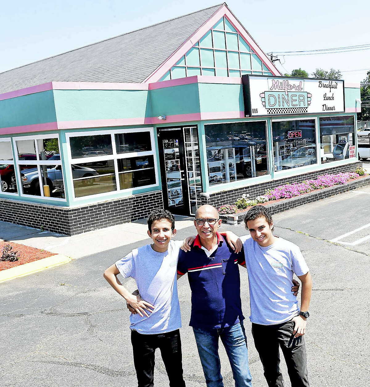 Owner Moe Elhelw, center, with his two sons Samir, 17, left, and Amir, 14, at his Milford Diner on Bridgeport Avenue.