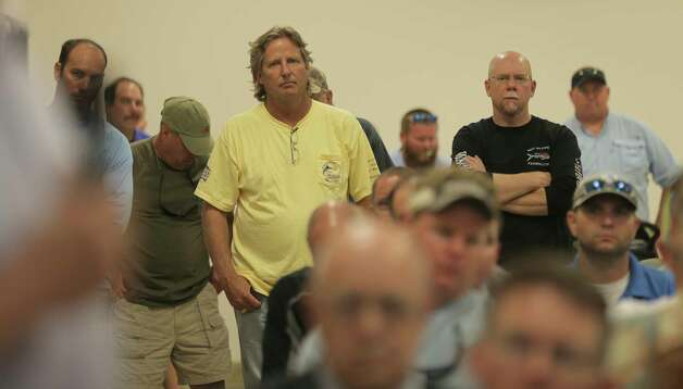Tom Hilton of Arcola, Texas, listens to other recreational fishermen gather at a Texas Parks & Wildlife Public Scoping Meeting regarding the red snapper season on Monday, June 12, 2017. Photo: Elizabeth Conley, Houston Chronicle / © 2017 Houston Chronicle