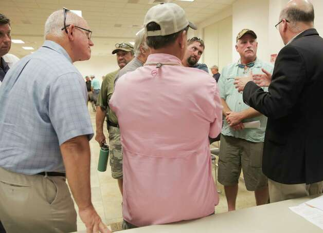 Robin Reichers, director of Texas Parks and Wildlife Dept. Coastal Fisheries Division, talks to recreational fishermen who attended a public scoping meeting regarding the red snapper season on Monday, June 12, 2017. Photo: Elizabeth Conley, Houston Chronicle / © 2017 Houston Chronicle