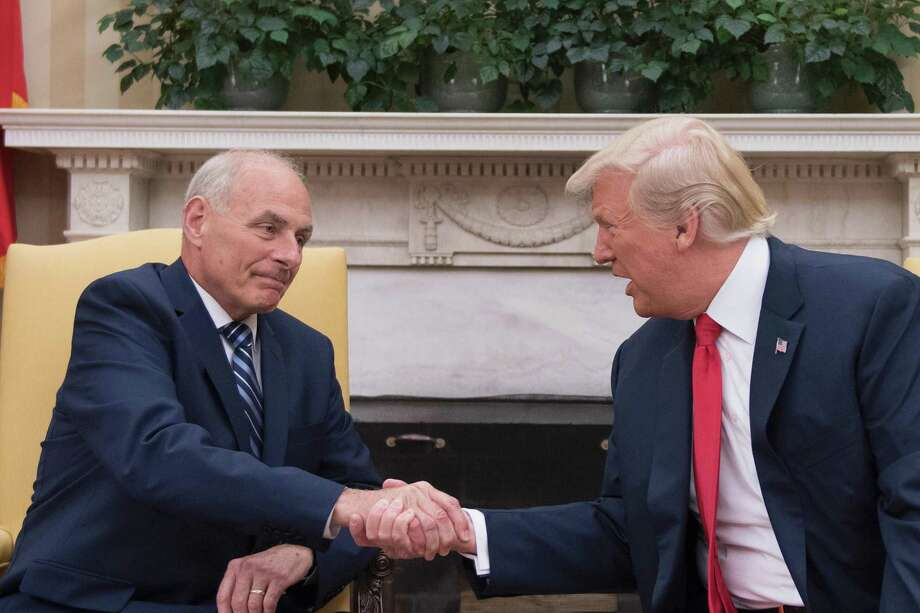 TOPSHOT - US President Donald Trump (R) shakes hands with newly sworn-in White House Chief of Staff John Kelly at the White House in Washington, DC, on July 31, 2017.   US President Trump on July 28, 2017 announced via Twitter that he had picked Kelly to replace outgoing chief of staff Reince Priebus, rumored for weeks to be on the verge of being sacked. The chief of staff traditionally manages the president's schedule and is the highest ranking White House employee, deciding who has access to the president.   / AFP PHOTO / JIM WATSONJIM WATSON/AFP/Getty Images Photo: JIM WATSON / AFP/Getty Images / AFP or licensors