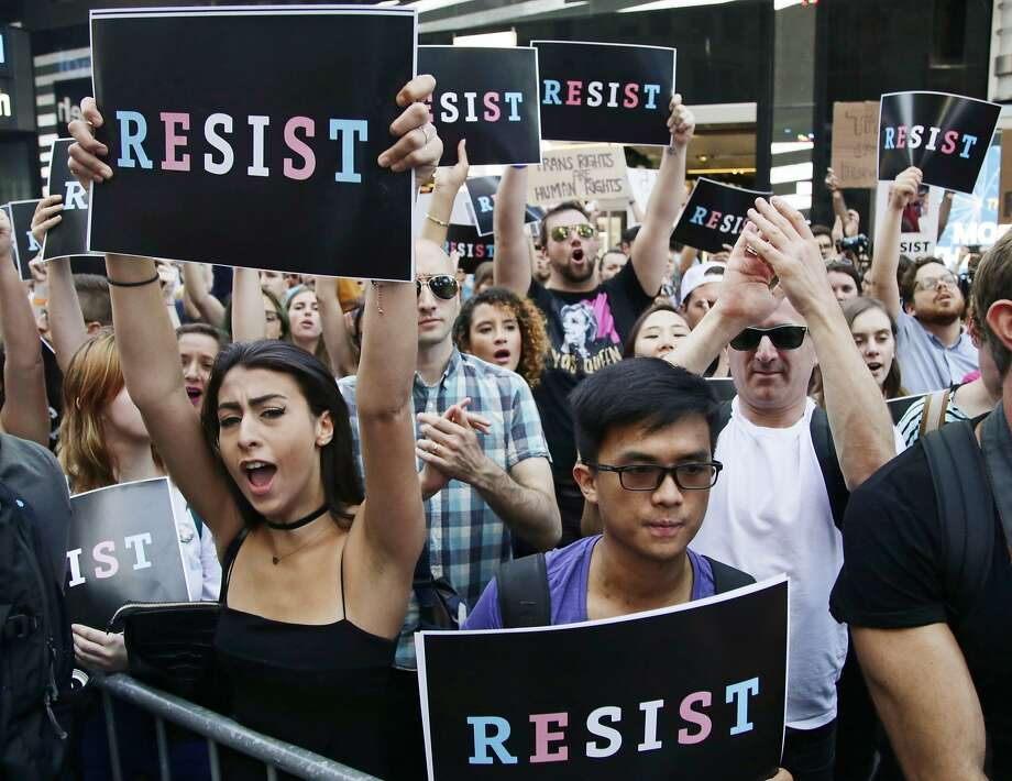 Protestors attend a rally July 26 in New York City to denounce President Trump's announcement of a ban on transgender troops. Photo: Frank Franklin II, Associated Press