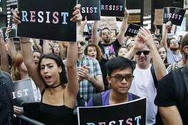 FILE - In this July 26, 2017, file photo, protestors attend a rally in New York City, to protest President Donald Trump's announcement of a ban on transgender troops serving anywhere in the U.S. military. Trump�s tweets declaring transgender individuals unwelcome in his military has plunged the Pentagon into a legal and moral quagmire, seeing off a flurry of meetings to devise a new policy that could lead to hundreds of service members being discharged. (AP Photo/Frank Franklin II, File)