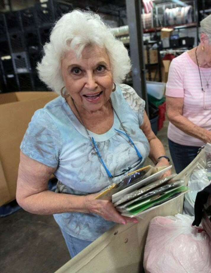Pictured volunteering at Bridgeport Rescue Mission, Rita Miko, 86, of Shelton, was the chosen recipient of the Bankers Life Golden Beacon award for her service to the community, a press release from Bankers Life said. Photo: Contributed Photo / Greg Schneider / ©gregschneider.com