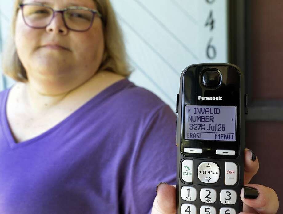 Jen Vargas shows the data of a recent robocall on her home phone in Orlando. An app at least helps on her cell phone. Photo: John Raoux, Associated Press
