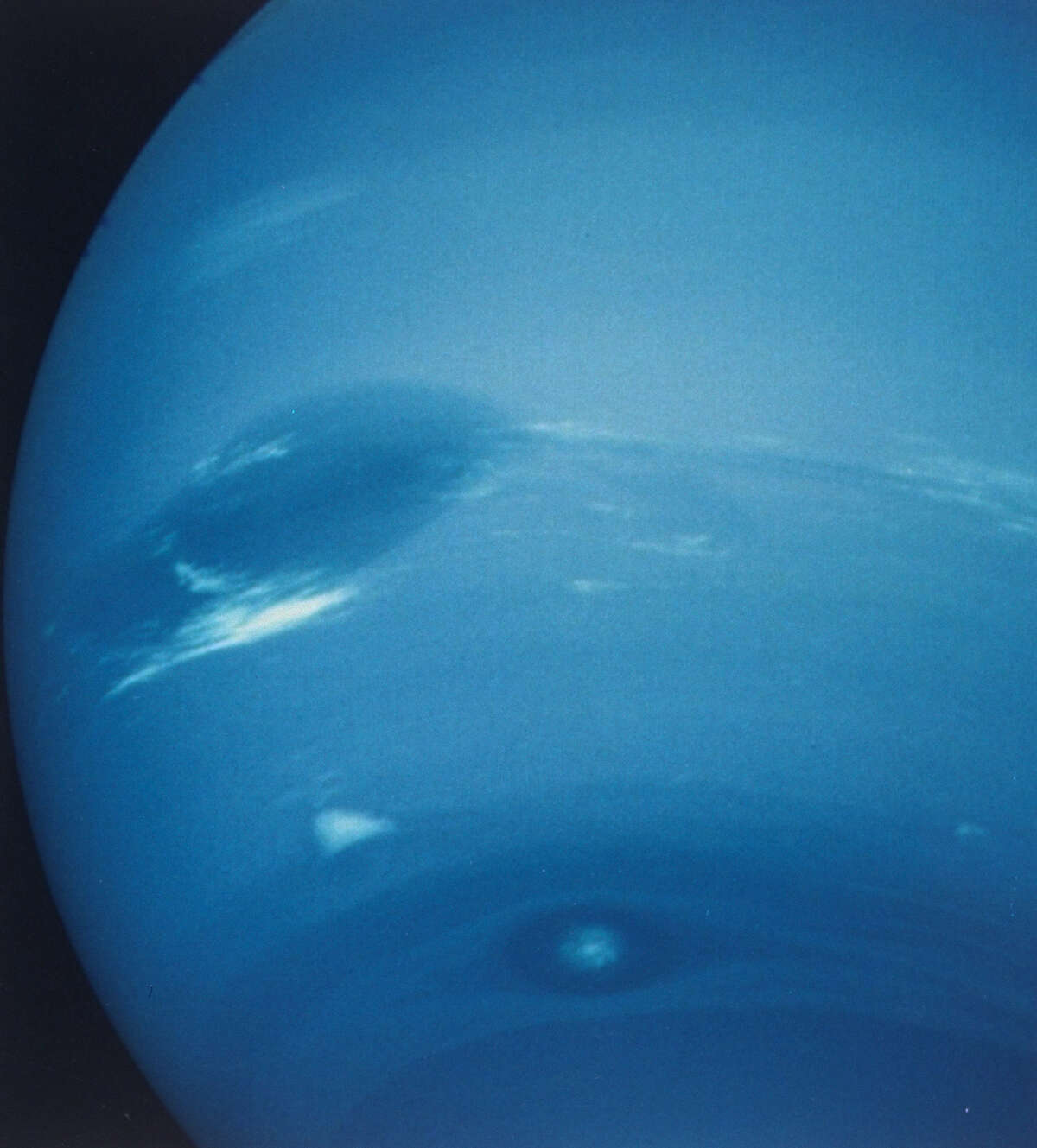 Neptune taken w. narrow-angle camera showing the Great Dark Spot w. cloud named Scooter beneath it, from spaceship Voyager II.