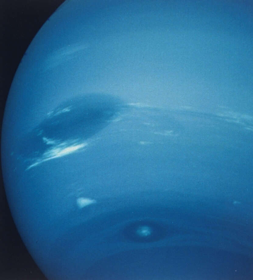 Neptune taken w. narrow-angle camera showing the Great Dark Spot w. cloud named Scooter beneath it, from spaceship Voyager II.  Photo: Time Life Pictures/The LIFE Picture Collection/Getty Images