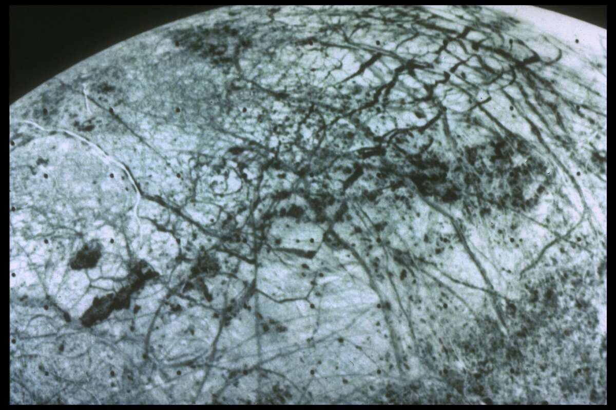 Jupiter's moon Europa, from 150,000 mi., as depicted by Voyager spacecraft.