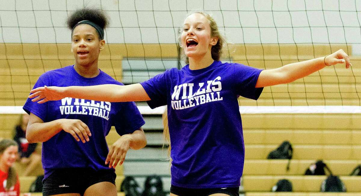 Willis players celebrate a point during a high school volleyball scrimmage at Oak Ridge High School, Friday, Aug. 4, 2017.