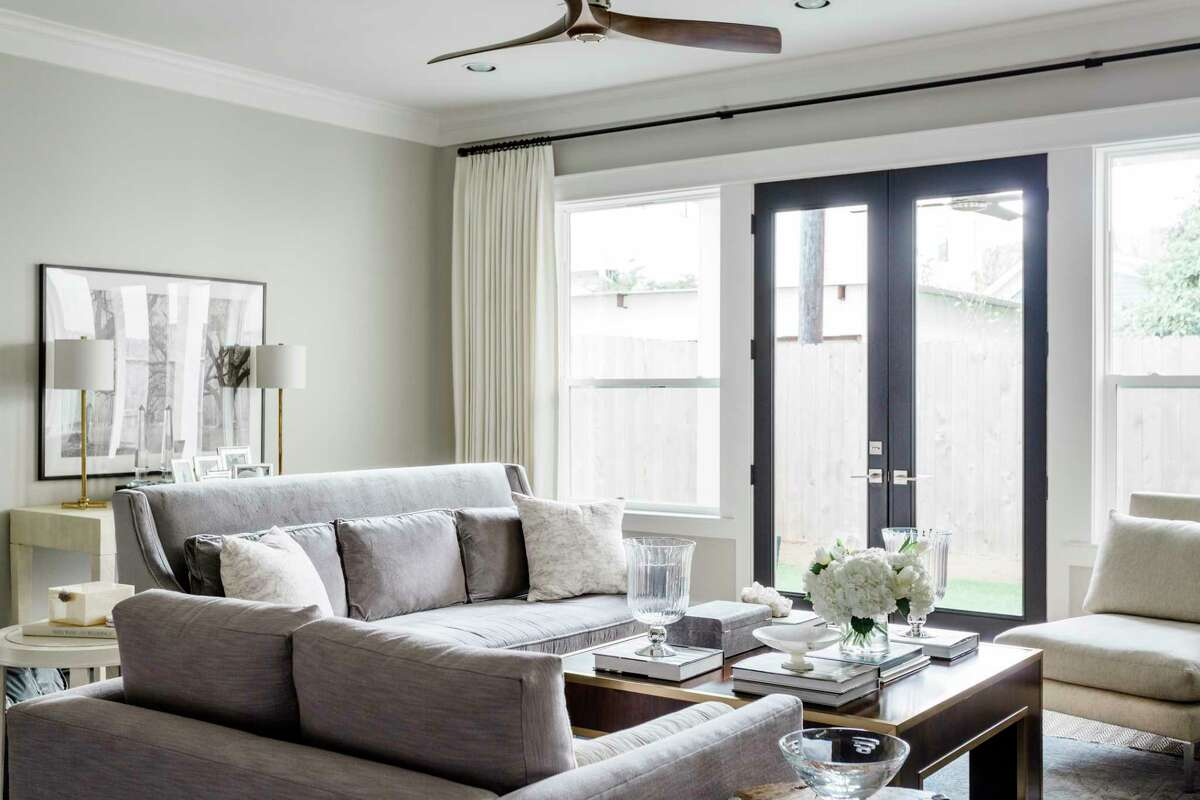 Changing a paint color in any room of your home is the most inexpensive way to get a new look. The living room in this home is painted Sherwin-Williams' Agreeable Gray, a popular paint color that's often recommended by interior designers.