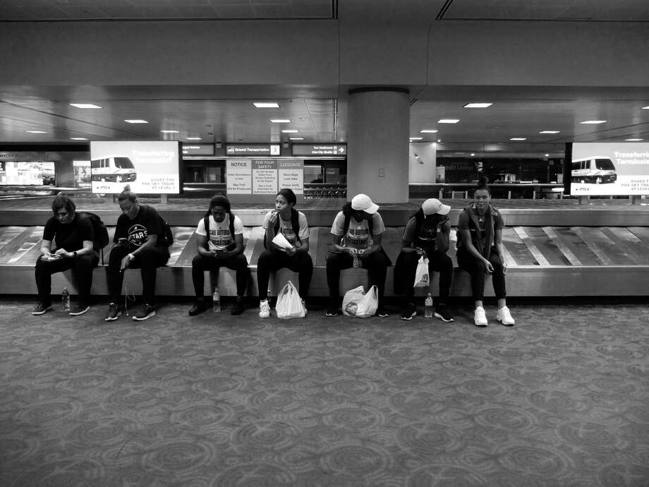 Stars' players and coaches wait for their luggage to unload after arriving in Phoenix for their game against the Phoenix Mercury on Saturday, July 29, 2017. The Stars travel on commercial flights for their out of town games. (Kin Man Hui/San Antonio Express-News) Photo: Kin Man Hui, Staff / San Antonio Express-News / ©2017 San Antonio Express-News