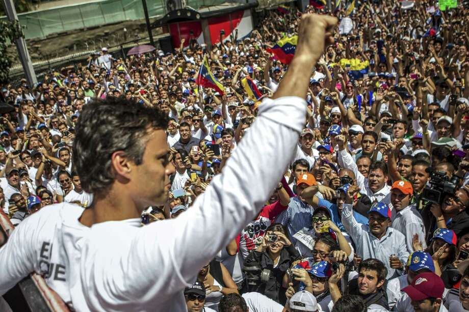 Opposition leader Leopoldo Lopez rallies supporters in 2014 before surrendering to police in Caracas, Venezuela. He was released, but masked government agents took Lopez and another figure from their homes last week, according to family members. So goes the Bolivarian Revolution. Photo: New York Times File Photo / NYTNS