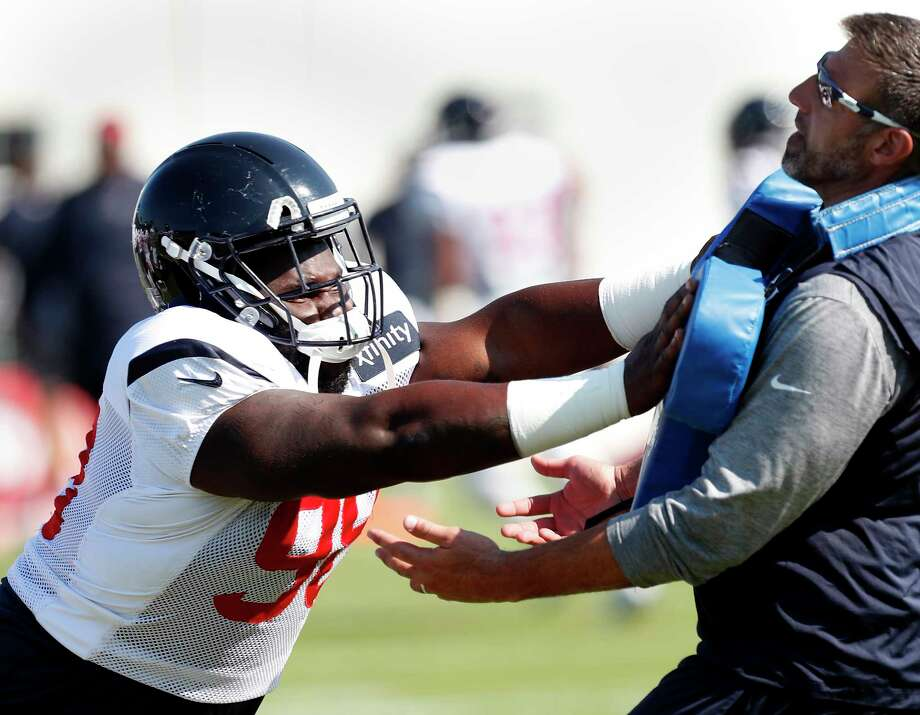 Houston Texans defensive end D.J. Reader, left, hits a blocking pad held by defensive coordinator Mike Vrabel during training camp at the Greenbrier on Friday, Aug. 4, 2017, in White Sulphur Springs, W.Va. ( Brett Coomer / Houston Chronicle ) Photo: Brett Coomer, Staff / © 2017 Houston Chronicle}