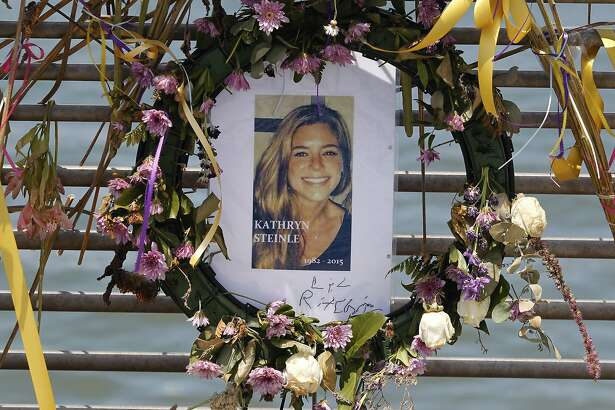 In this Friday, July 17, 2015 photo, flowers and a portrait of Kate Steinle are displayed at a memorial site on Pier 14 in San Francisco, Calif., for Steinle, who was gunned down by Juan Francisco Lopez-Sanchez, a Mexican citizen who authorities contend was in the country illegally. Lopez Sanchez, who was deported five times, admits fatally shooting Steinle while she walked with her father two years ago on the San Francisco pier crowded with tourists. He has said the shooting was accidental and has pleaded not guilty to second-degree murder. (Paul Chinn /San Francisco Chronicle via AP)