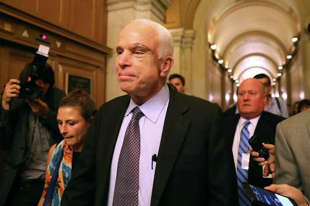 Republican Sen. John McCain leaves the Senate after voting against the GOP's attempt to repeal the Affordable Care Act in 2017. Since Obamacare became law, Republicans have voted 70 times to end it and yet have never produced a plan to protect Americans with pre-existing conditions.