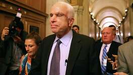 "Sen. John McCain, R-Ariz., leaves the Senate after voting ""no"" on the GOP's health care bill July 28. But on an equally bad bill introduced by Republicans, McCain this week showed signs of wobbling."